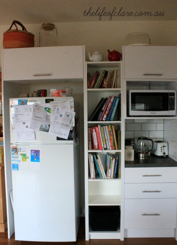 fridge, bookshelf and coffee station